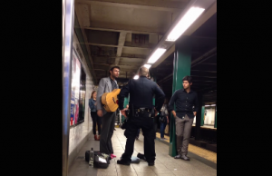 nypd assault subway musician